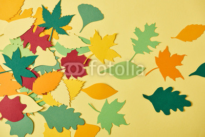 Fotoboard na płycie - flat lay with colorful papercrafted foliage arranged on yellow background